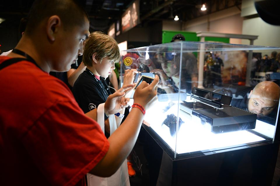 Attendee takes photos of the Xbox One at the GameStop Expo in Las Vegas on Wednesday, Aug. 28, 2013. (Photo by Al Powers/Invision/AP)