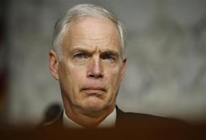 US Senator Ron Johnson listens to Secretary of State Hillary Clinton in Washington respond to questions about the September attack in Libya