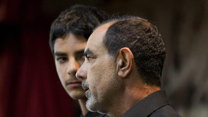 FILE - In this March 27,2012 file photo showing Kassim Alhimidi, right, speaks alongside his son, Mohammed Alhimidi, during a memorial for his wife, Shaima Alawadi at a mosque in Lakeside, Calif. Southern California police have arrested the husband of the Iraqi-American woman whose beating death last March initially raised fears of a hate crime. El Cajon police Chief Jim Redman said Friday that Kassim al-Himidi was booked on suspicion of murder in the death of 32-year-old Shaima Alawadi in her home. (AP Photo/Gregory Bull,File)