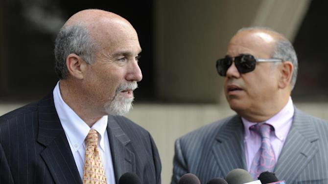 Joel Brodsky left, and Joe Lopez, right, defense attorneys for former Bolingbrook, Ill., police officer Drew Peterson, speak to the media outside the Will County Courthouse in Joliet, Ill., Monday, Aug. 27, 2012, during a break in Peterson's murder trial. The judge in the case rejected a request by the defense to acquit Peterson after prosecutors rested Monday. Peterson has pleaded not guilty to first-degree murder in the 2004 death of his third wife, Kathleen Savio. (AP Photo/Paul Beaty)