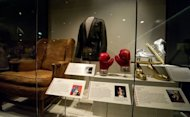 Muhammad Ali's boxing gloves from his 1974 defeat of champion George Foreman for the world Heavyweight title are displayed as part of the Smithsonian Mueseum of American History's new exhibition showcasing stories about the American experience
