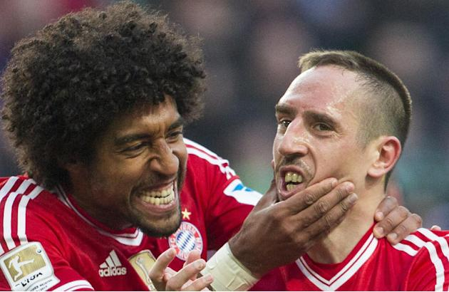 Bayern's Dante of Brazil, left, and Bayern's Franck Ribery of France celebrate after teammate Arjen Robben scored his side's 4th goal during the German Bundesliga soccer match between VfL