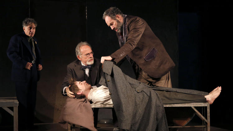 "This theater image released by The Public Theater shows, from left, Chip Zien, Ron Rifkin, Noah Robbins, and Daniel Oreskes in ""The Twenty-Seventh Man,"" running at The Public Theater at Astor place through Dec. 9. (AP Photo/The Public Theater, Joan Marcus)"
