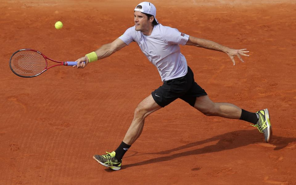 Germany's Tommy Haas returns the ball to Serbia's Novak Djokovic during their quarterfinal match of the French Open tennis tournament at the Roland Garros stadium Wednesday, June 5, 2013 in Paris. (AP Photo/Michel Euler)