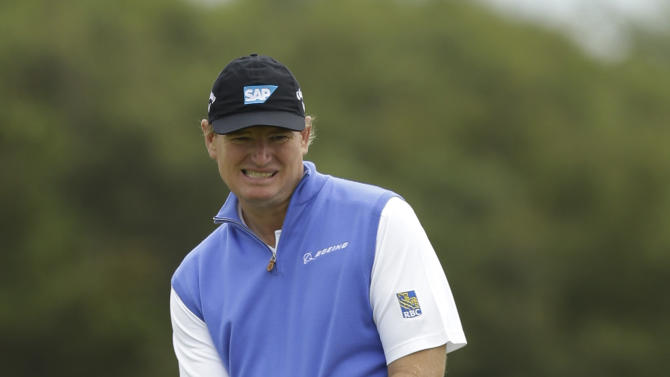 FILE - This July 19, 2012 file photo shows Ernie Els of South Africa reacting to a putt on the 11th green at Royal Lytham & St Annes golf club during the first round of the British Open Golf Championship in Lytham St Annes, England. Golf's governing bodies, worried that players will turn to long putters as an advantage instead of a last resort, proposed a new rule Wednesday, Nov. 28, 2012, that would ban the putting stroke used by three of the last five major champions.  (AP Photo/Jon Super, File)