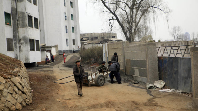 North Koreans are seen at a residential compound in Pyongyang, North Korea, Thursday, April 12, 2012. (AP Photo/Ng Han Guan)