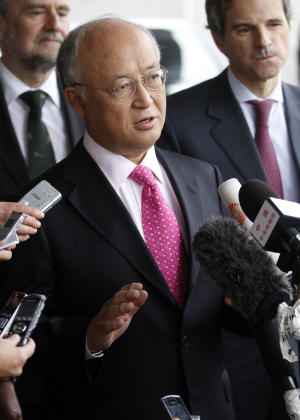 """Director General of the International Atomic Energy Agency, IAEA, Yukiya Amano from Japan speaks to the media after returning from Iran at the Vienna International Airport near Schwechat, Austria, on Tuesday, May 22, 2012. Amano says he has reached a deal with Iran on probing suspected work on nuclear weapons and adds that the agreement will """"be signed quite soon."""" (AP Photo/Ronald Zak)"""