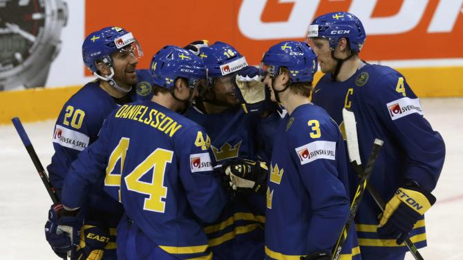 Sweden's Josefson celebrates his goal against Latvia with team mates during their Ice Hockey World Championship game at the O2 arena in Prague