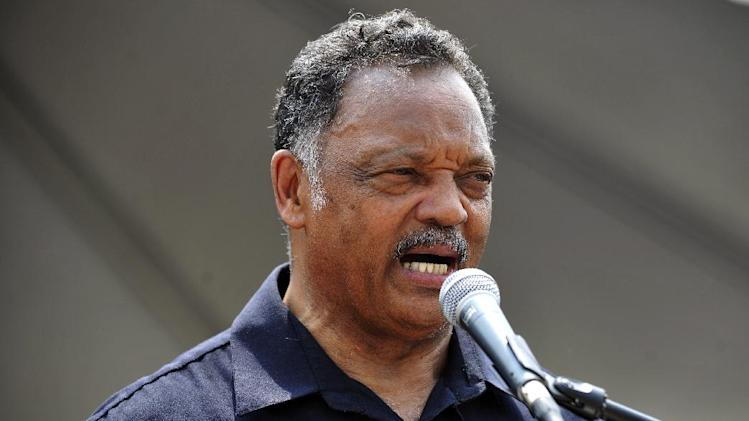 Rev. Jesse Jackson speaks during a rally in Hart Plaza which followed the Freedom Walk down Woodward Avenue to commemorate Martin Luther King Jr.'s historic march 50 years ago, Saturday, June 22, 2013 in Detroit. (AP Photo/Detroit News, John T. Greilick) DETROIT FREE PRESS OUT; HUFFINGTON POST OUT