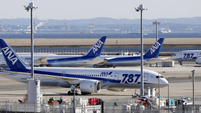 """FILE - In this Jan. 18, 2013 file photo, All Nippon Airways' Boeing 787 """"the Dreamliner"""" passenger jets are parked on the tarmac at Haneda airport in Tokyo. Documents related to a federal investigation into a battery fire aboard a Boeing 787 show firefighters struggling to tame a small but worrisome blaze that has left investigators relieved that it happened after a flight and not during one.  Another smoldering battery nine days later in Japan prompted the grounding of 787s worldwide. Investigators still don't know the root cause. (AP Photo/Koji Sasahara, File)"""