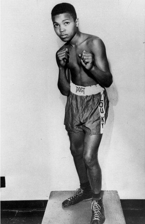 FILE - In this 1954 file photo, boxer Cassius Clay is shown. Long before his dazzling footwork and punching prowess made him a three-time world heavyweight boxing champion known as Muhammad Ali, a you