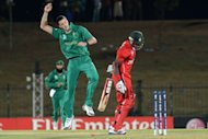 South African cricketer Morne Morkel (C) celebrates after he dismissed Zimbabwe cricketer Vusi Sibanda during their ICC Twenty20 Cricket World Cup match at The Mahinda Rajapaksa International Cricket Stadium in Hambantota. South Africa won by 10 wickets