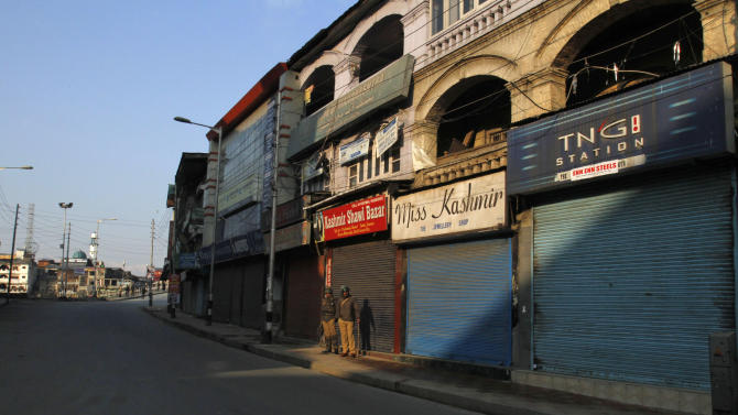 Indian paramilitary soldiers stand guard at a market area during curfew in Srinagar, India, Saturday, Feb. 9, 2013. A Kashmiri man Mohammed Afzal Guru, convicted in the 2001 attack on India's Parliament, has been hanged in an Indian prison, a senior Indian Home Ministry official said Saturday. On Saturday morning thousands of police and paramilitary troops had fanned out across Indian Kashmir anticipating that protests and violence might follow news of the execution. (AP Photo/Mukhtar Khan)