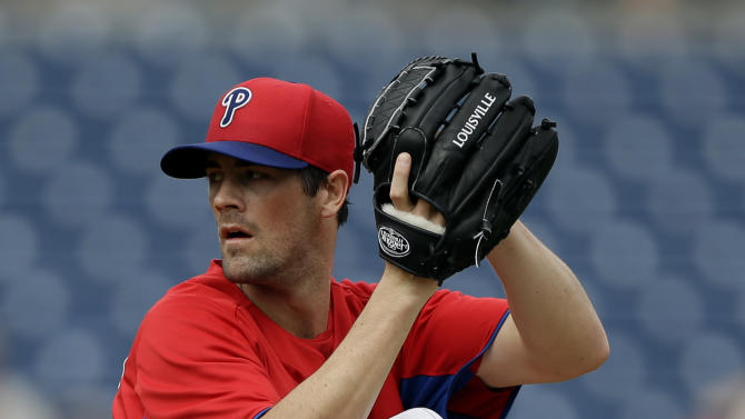 "FILE - In this Feb. 23, 2013, file photo, Philadelphia Phillies pitcher Cole Hamels delivers against the Houston Astros during an exhibition spring training baseball game in Clearwater, Fla. Hamels says it's an ""honor"" to start on opening day and he'll ""cherish"" his first assignment when the Phillies begin the season against the Braves at Atlanta on April 1. (AP Photo/Matt Slocum, File)"