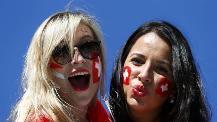 Switzerland fans pose before the 2014 World Cup round of 16 game between Argentina and Switzerland at the Corinthians arena