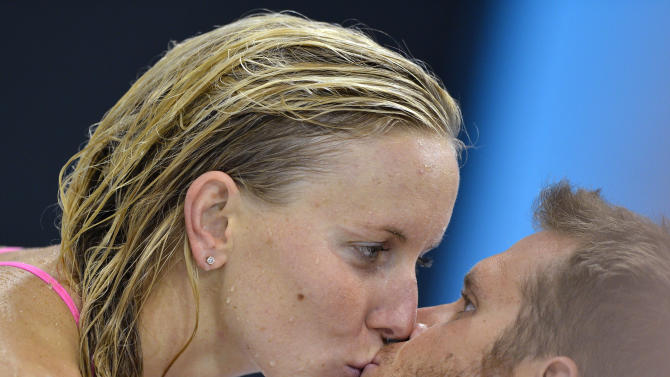 Jessica Hardy of the U.S. kisses her boyfriend Dominik Meichtry at the Aquatics Centre before the start of the London 2012 Olympic Games