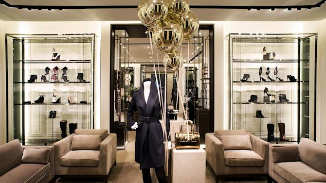 This undated publicity photo provided by BURBERRY shows shoes in an interior view of the new BURBERRY Flagship store opened in November 2012 on Michigan Avenue in Chicago. BURBERRY is interacting directly with consumers in the digital sphere too, launching projects like artofthetrench.com. The website invites users to upload pictures of themselves wearing BURBERRY trench coats. (AP Photo/BURBERRY)