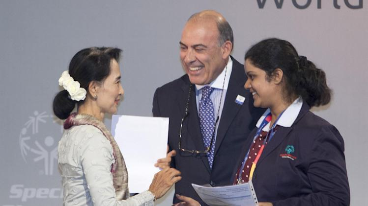 IMAGE DISTRIBUTED FOR SPECIAL OLYMPICS - The Coca-Cola Company CEO Muhtar Kent, center, greets Aung San Suu Kyi, left, during the Special Olympics Global Development Summit in PyeongChang, South Korea on the second day of the competition, Wednesday, Jan. 30, 2013. Around 300 leading figures from around the world gather at the Convention Center of Alpensia Resort PyeongChang to discuss the cycle of poverty and social exclusion for people with intellectual disabilities. (Manchul Kim/AP Images for Special Olympics)