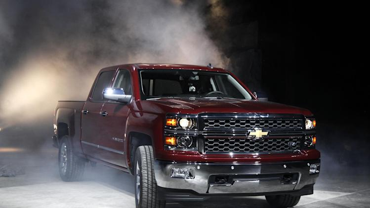 The 2014 Chevrolet Silverado debuts in Pontiac, Mich., Thursday, Dec. 13, 2012. The models roll into a market where truck sales are growing after a five-year slump. (AP Photo/Paul Sancya)