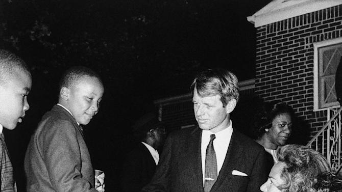 FILE - Ethel Kennedy shakes hands with Martin Luther King III after she and her husband Robert F. Kennedy, center, visited his mother Coretta Scott King at her Atlanta home, April 8, 1968. Another of the slain civil rights leader's sons, Dexter, is at left.  The civil rights leader was standing on the balcony of the Lorraine Motel when he was killed by a rifle bullet on April 4, 1968. James Earl Ray pleaded guilty to the killing and was sentenced to 99 years in prison. He died in prison in 1998. (AP Photo)