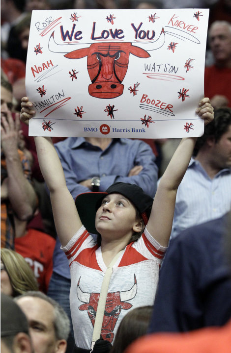 A Chicago Bulls fan holds a sign during the second quarter of Game 5 in an NBA basketball first-round playoff series between the Bulls and the Philadelphia 76ers in Chicago on Tuesday, May 8, 2012. (A