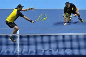 Bob Bryan of the U.S. slips as his brother Mike Bryan plays a shot during ATP World Tour Finals in London