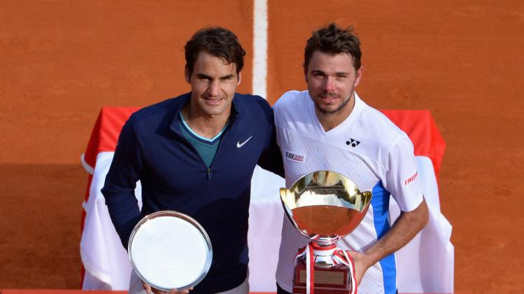 Wawrinka of Switzerland poses with his trophy after winning the final tennis match against compatriot Federer at the Monte Carlo Masters in Monaco