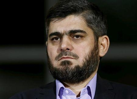 Senior Syrian rebel negotiator says will head rebel delegation at peace talks
