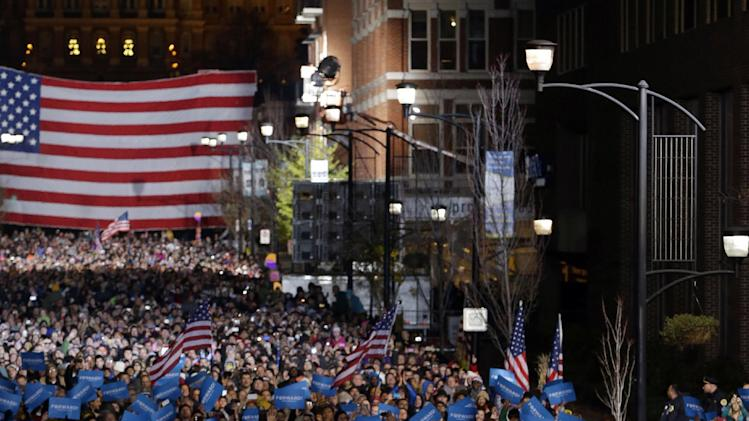 President Barack Obama and first lady Michelle Obama on stage together during his final 2012 campaign event in downtown Des Moines, Iowa, Monday, Nov. 5, 2012. (AP Photo/Pablo Martinez Monsivais)