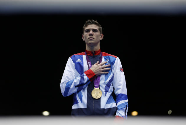 Luke Campbell of Britain celebrates with his gold medal during the presentation ceremony for the Men's Bantam (56kg) boxing competition at the London Olympics