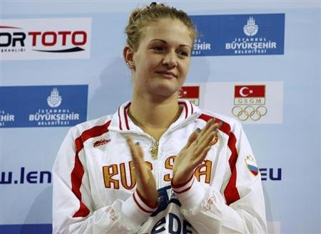 Ksenia Moskvina of Russia gestures during the medal ceremony for the women's 100m backstroke final at the European Short Course Swimming Championships in Istanbul
