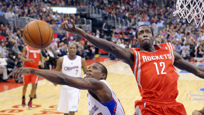 Los Angeles Clippers guard Eric Bledsoe, left, blocks the shot of Houston Rockets guard Patrick Beverley during the first half of their NBA basketball game, Wednesday, Feb. 13, 2013, in Los Angeles. (AP Photo/Mark J. Terrill)