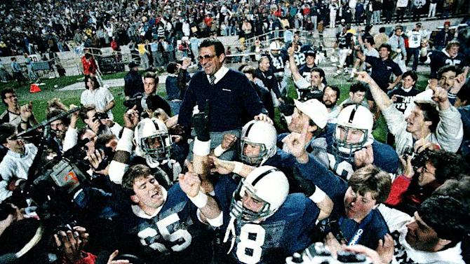 FILE - In this Jan. 2, 1987 file photo, Penn State coach Joe Paterno is carried after defeating Miami, 14-10,  in the Fiesta Bowl, to win the national championship, in Tempe, Ariz. Paterno say he plans to retire at the end of the season, his long and illustrious career brought down because he failed to do all he could about an allegation of child sex abuse against a former assistant. (AP Photo/Jim Gerberich, File)