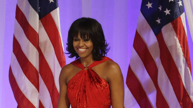 First lady Michelle Obama arrives Commander-in-Chief's Inaugural Ball at the 57th Presidential Inauguration in Washington, Monday, Jan. 21, 2013. (AP Photo/Jacquelyn Martin)