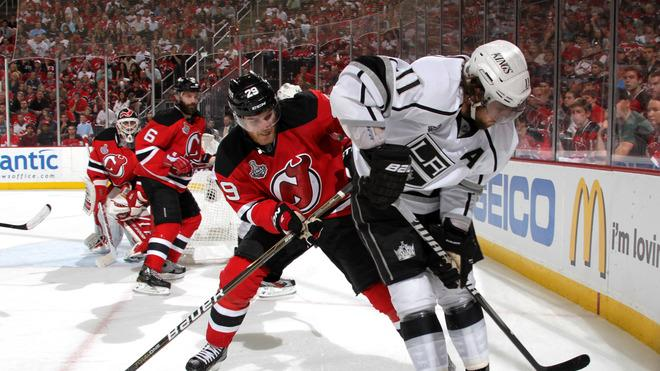 Mark Fayne #29 Of The New Jersey Devils And Anze Kopitar #11 Of The Los Angeles Kings Fight For A Loose Puck  Getty Images