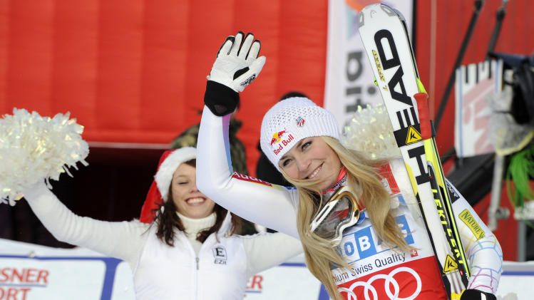Lindsey Vonn, right, of the United States, celebrates after winning an alpine ski, women's World Cup super-G, in St. Moritz, Switzerland, Saturday, Dec .8, 2012. (AP Photo/Giovanni Auletta)