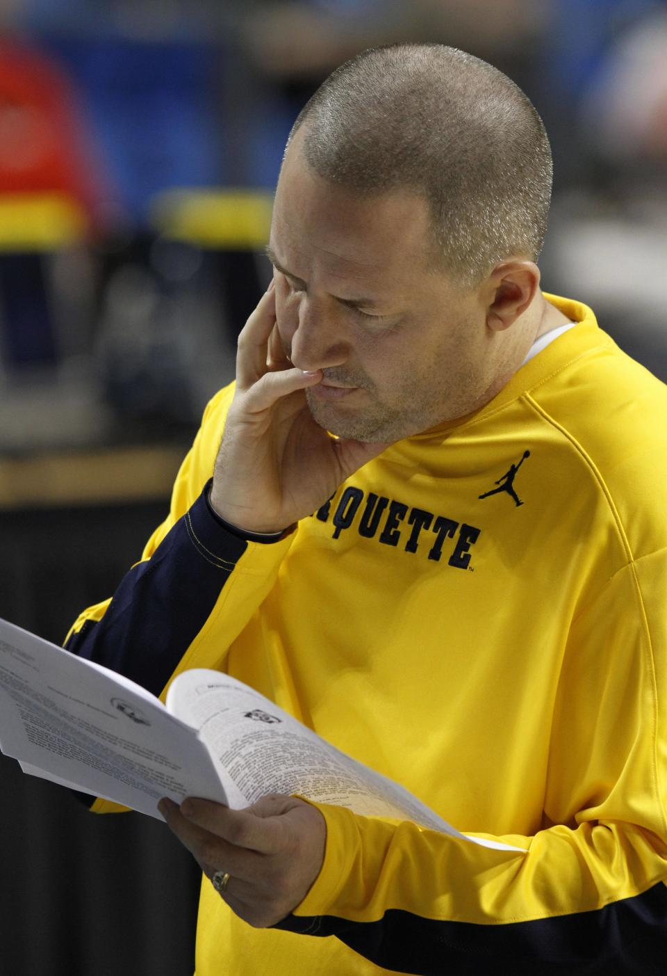 Marquette head coach Buzz Williams reads during practice for the second round of the NCAA college basketball tournament Wednesday, March 20, 2013, in Lexington, Ky. Marquette play Davidson on Thursday. (AP Photo/James Crisp)