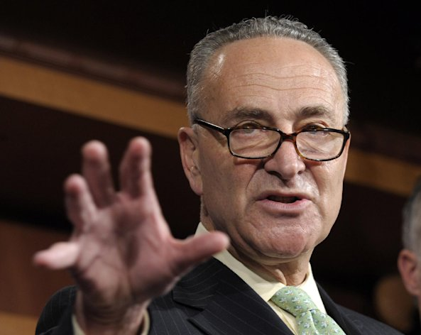 FILE - In this May 17, 2012 file photo, Sen. Charles Schumer, D-N.Y. gestures during a news conference on Capitol Hill in Washington. Democrats want to push tax cuts through the Senate for companies that hire new workers, give raises or buy major new equipment this year. With neither party eager to let the other claim campaign-season victories, the ultimate fate of the roughly $29 billion legislation seems dubious. Debate was to begin Tuesday, though it was possible Republicans would use procedural blockades to quickly derail the measure. (AP Photo/Susan Walsh, File)