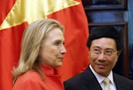 US Secretary of State Hillary Clinton (L) is greeted by Vietnam's Foreign Minister Pham Binh Minh at the Government Guest House in Hanoi. Clinton witnessed the signing of two deals between General Electric and Vietnam's biggest state-owned telecoms group Vietnamese National Power Transmission Corporation, and a private Vietnamese company