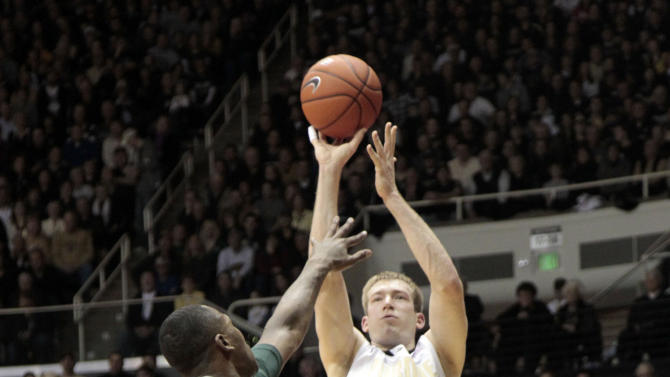 Purdue forward Robbie Hummel, right, shoots over Michigan State center Derrick Nix in the first half of an NCAA college basketball game in West Lafayette, Ind.  Sunday, Feb. 19, 2012. (AP Photo/AJ Mast)