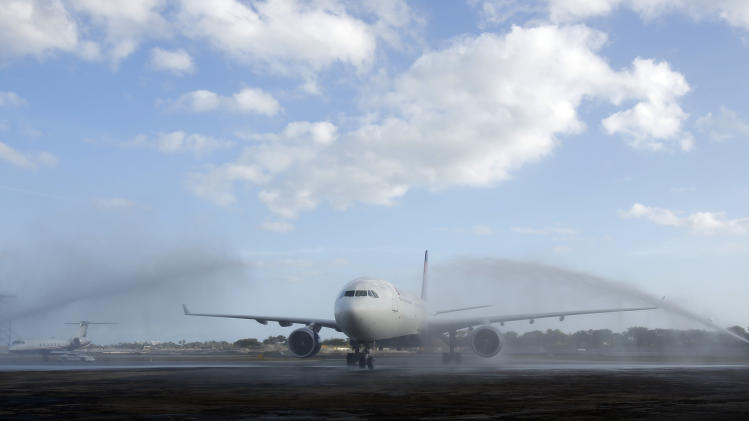 The plane carrying the Notre Dame football teams is sprayed with water after arriving in Fort Lauderdale, Fla., Wednesday, Jan. 2, 2013. Notre Dame takes on Alabama in the BC national championship NCAA college football game next Monday in Miami. (AP Photo/Al