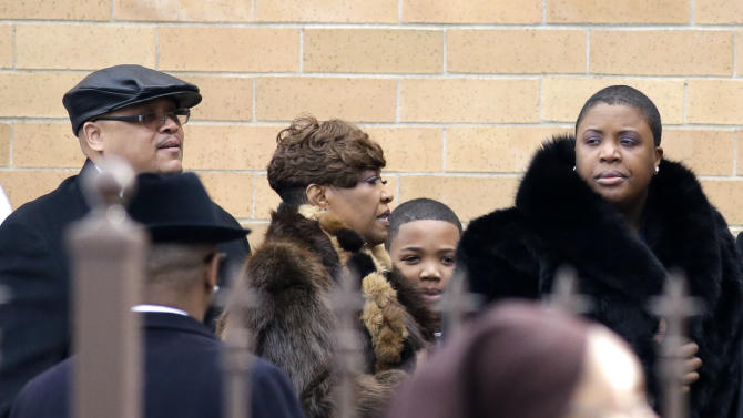 Father Nathaniel Pendleton, left, his son Nathaniel Jr. and mother Cleopatra Pendleton, right, arrive for the funeral of their daughter and sister Hadiya Pendleton at the Greater Harvest Missionary Baptist Church Saturday, Feb. 9, 2013, in Chicago. The shooting death of the 15-year-old honor student has drawn attention to the staggering gun violence in the nation's third-largest city. (AP Photo/Nam Y. Huh)