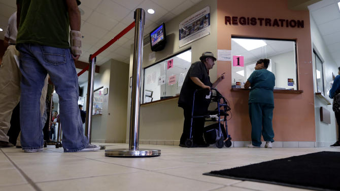 Patients wait in line at Nuestra Clinica Del Valle, Thursday, Sept. 6, 2012, in San Juan, Texas. (AP Photo/Eric Gay)