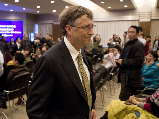Microsoft Corp. co-founder Bill Gates leaves after he delivered a speech at the Ministry of Science and Technology in Beijing Wednesday, Dec. 7, 2011. Gates confirmed Wednesday he is in discussions with China to jointly develop a new kind of nuclear reactor. (AP Photo/Andy Wong)