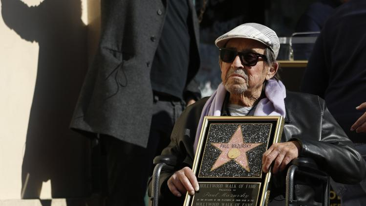 Mazursky poses on his star after it was unveiled on the Walk of Fame in Hollywood