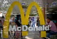 Customers at a McDonald's outlet in New Delhi. US fast-food giant McDonald's, famed for its beef-based Big Mac burgers, on Tuesday said it will open its first vegetarian-only restaurant anywhere in the world in India next year