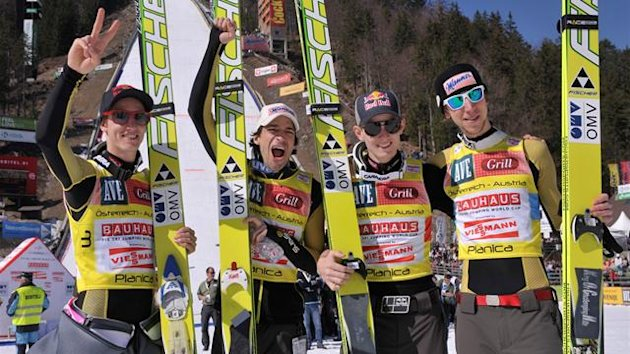 Members of team Austria celebrate victory after the ski jumping World Cup Flying Hill Team event in Planica March 17, 2012.