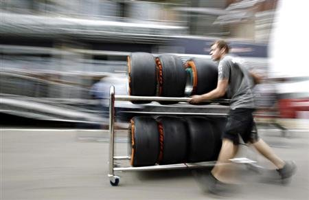 A Petronas mechanic pushes a trolley with Pirelli tyres in the paddock ahead of the Spanish Formula One Grand Prix at the Circuit de Catalunya in Montmelo, near Barcelona May 9, 2013. REUTERS/Albert G