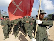 Shan State Army soldiers parade during an officers' graduation ceremony at Doi Taileang in Myanmar the in 2006. Myanmar's government and ethnic rebels engaged in peace talks signed a deal Saturday to wipe out drug production in Shan state, a minister involved in negotiations told AFP