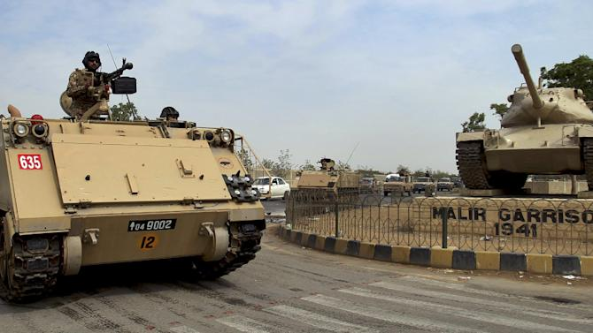 Pakistani army troops ride military vehicles as they leave the Malir cantonment for deployment, Saturday, Nov. 1, 2014 in Karachi, Pakistan. Pakistani authorities decided to deploy army troops in sensitive areas during mourning days of Muharram, the first month of the Islamic calendar, which is observed around the world for ten days of mourning in remembrance of the martyrdom of Imam Hussein, the grandson of Prophet Mohammed. (AP Photo/Fareed Khan)